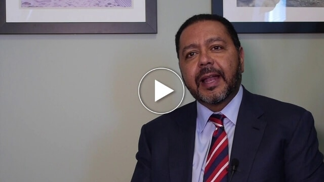 Dr. Besh Video Background of black man in a black suit