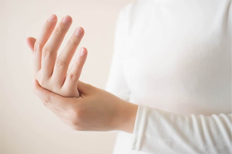 Background image of Caucasian person in white with hand pain