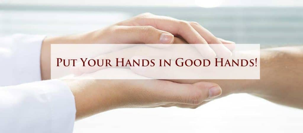 A hand therapist holding the hands of a patient with the words put your hands in good hands