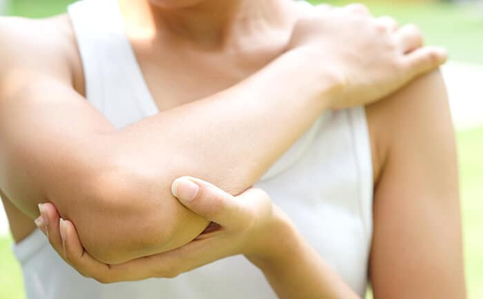 person with elbow pain