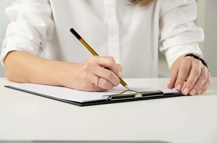 a woman filling out paperwork
