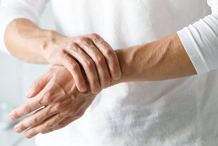 an elderly person with wrist pain
